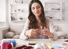 Handmade earrings making, home workshop. Woman artisan create tassel jewelry. Art, hobby, handicraft concept Stock Images