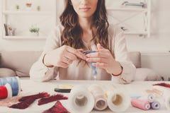 Handmade earrings making, home workshop. Woman artisan create tassel jewelry. Art, hobby, handicraft concept Stock Photography