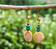 Handmade earrings Turquoise and Mother pearl stock image