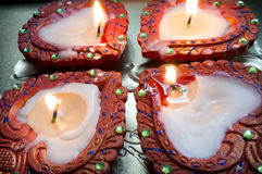 Handmade earthenware candles (diyas) for diwali. Handmade earthenware wax diyas (Wax lamps) typically lit on the Indian festival of diwali Royalty Free Stock Photos
