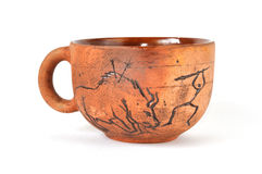 Handmade earthenware cup in ancient art style. Isolated on white stock photography