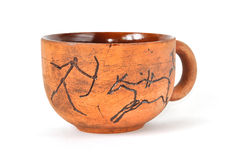 Handmade earthenware cup in ancient art style. Isolated on white stock photo