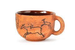 Handmade earthenware cup in ancient art style Stock Images