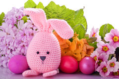 Easter bunny with colorful flowers and easter eggs Stock Photos
