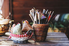 Handmade easter decorations, fabric chicken and sticks in country house Royalty Free Stock Photo