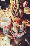Handmade easter decorations on wooden table in cozy country house, vintage toned Stock Photo