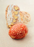 Handmade Easter egg and natural heart on sackcloth. Happy Easter Stock Images