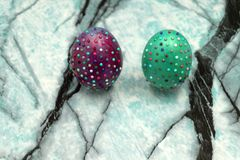 Handmade easter egg with rhinestones in front of a white background . stock photos