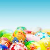Handmade Easter eggs on blue sky. Spring patterns Stock Image