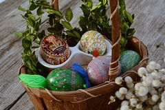 Handmade, easter eggs close up. Handmade, easter eggs and willow in basket close up Royalty Free Stock Photography
