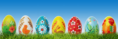 Handmade Easter eggs on grass. Panorama, banner. Stock Photos