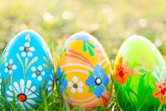Handmade Easter eggs on grass. Spring patterns art Stock Photos