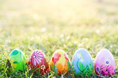 Handmade Easter eggs on grass. Spring patterns art Stock Images