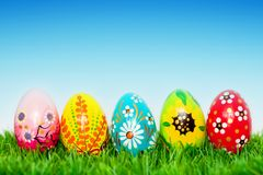 Handmade Easter eggs on grass. Spring patterns Royalty Free Stock Image