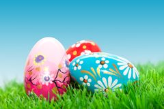 Handmade Easter eggs on grass. Spring patterns Stock Photography