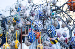 Handmade easter eggs hang tree branch spring fair Stock Photography