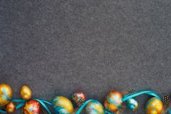 Handmade easter eggs  on white. Perfect colorful handmade easter eggs on gray textile background , shape of border frame corner with copy space for text content royalty free stock image