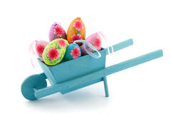 Handmade Easter eggs in a wheelbarrow Stock Photo