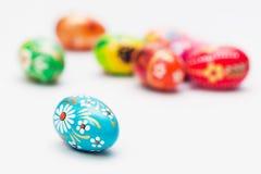 Handmade Easter eggs on white. Spring patterns art Stock Photos