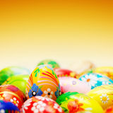 Handmade Easter eggs on yellow background. Spring patterns Royalty Free Stock Images