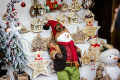Handmade Eco style Christmas wooden decorations with snowman and little houses stock photos
