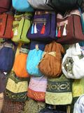 Handmade egyptian fabric bags and scarves at souq bazaar. Cothing for sale in Bazaar Clothing on display for sale in Khan el-Khalili Bazzar in Cairo.  Handmade Stock Image