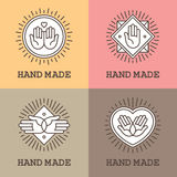 Handmade emblems with hand icons. Set of four linear labels and emblems with hands for handmade, massage or charity design concept Stock Photos