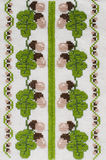 Handmade embroidery by cross stitch. Handmade Embroidery by Cross Stitch in the View of Acorns. Texture of Beige Natural Linen Fabric with Embroidery for Royalty Free Stock Photography