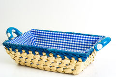 Handmade empty wicker basket with colored cloth on white background royalty free stock photo