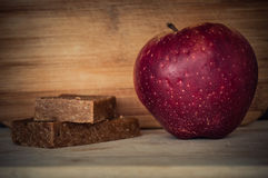 Handmade enery bars and one apple Stock Image