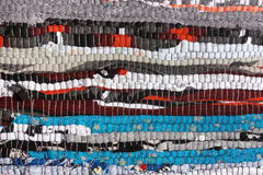 Handmade fabric texture motley rug or carpet Stock Photo