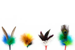 Handmade Feather Cat Toys Border. Colorful handmade feather cat toys as attachment for teaser wand and rod. On white background with lots of copy space Stock Images