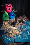 Handmade feeder for birds in wooden workshop Stock Images