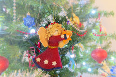 Handmade felt angel Christmas ornament craft hanging from a vint Royalty Free Stock Image