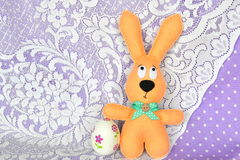 Handmade felt beige rabbit and decoupage egg. Easter symbols. Simple Easter crafts Royalty Free Stock Photo
