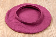 Handmade felt beret is drying on wooden table Royalty Free Stock Images