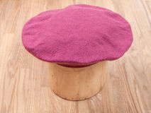 Handmade felt beret is molded on wooden hat block Royalty Free Stock Photos