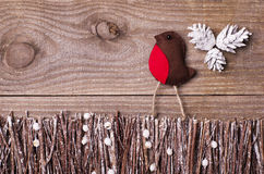 Handmade from felt bird robin on wooden background. Craft arrang Royalty Free Stock Photography