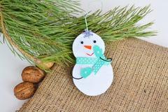 Handmade felt Christmas snowman toy. Felt decoration Royalty Free Stock Photo