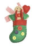 Handmade felt Christmas stocking doll stock photo