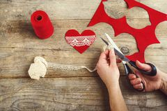 Handmade felt heart on a wooden floor. Royalty Free Stock Images