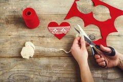 Handmade felt heart on a wooden floor. Royalty Free Stock Images