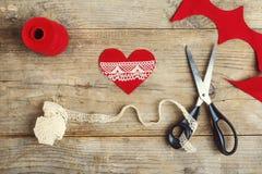 Handmade felt heart on a wooden floor. Royalty Free Stock Photography