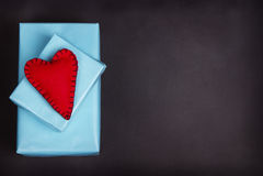 Handmade felt hearts  on a blank chalkboard. Royalty Free Stock Images