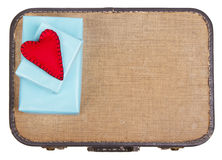 Handmade felt hearts sitting on presents on top of a suitcase Stock Photography