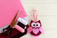 Handmade felt owl. Cute children's toy. Felt sheets, scissors, thread, needles, pins - sewing kit. DIY concept Royalty Free Stock Photography