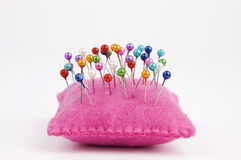 Pin cushion. Handmade felt pin cushion with multicolored sewing pins stuck in royalty free stock photography