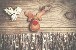Handmade from felt Rudolph reindeer on wooden background. Craft Royalty Free Stock Image