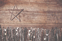 Handmade from felt star on wooden background. Craft arranged fro Stock Photography