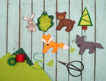 Handmade felt toys animals over wooden rustic background. Felt t Stock Photography